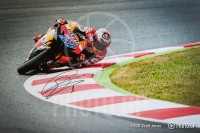 Casey Stoner with elbow down at Catalunya 2011 MotoGP