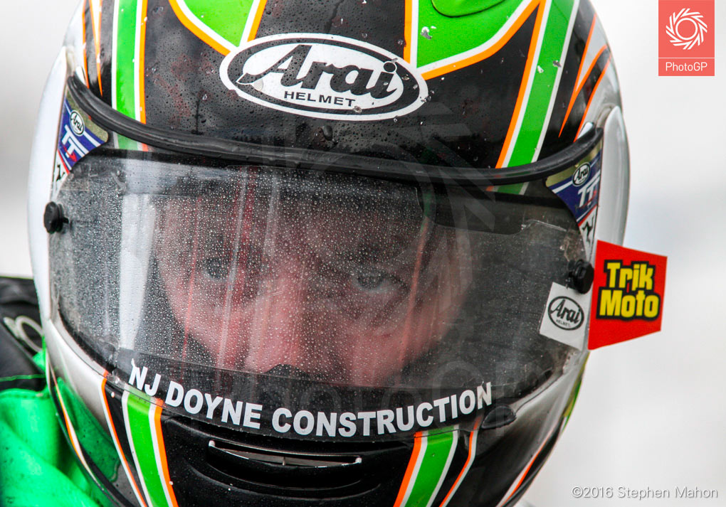 11_Derek-McGee-looks-through-a-rain-soaked-visor-before-the-race