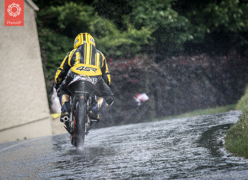 3_A-rider-negotiates-the-wet-roads-during-the-125cc-race